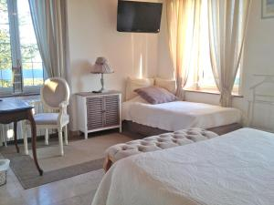 A bed or beds in a room at Mansion with 4 bedrooms in LES AVENIERES VEYRINS THUELLIN with wonderful mountain view private pool enclosed garden