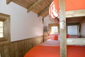 A bed or beds in a room at Harvest Moon Treehouse