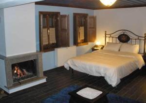 Ένα ή περισσότερα κρεβάτια σε δωμάτιο στο Hotel Dryades