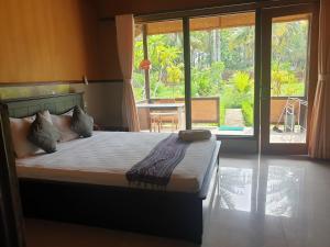 Ein Bett oder Betten in einem Zimmer der Unterkunft Kulkul Bungalow