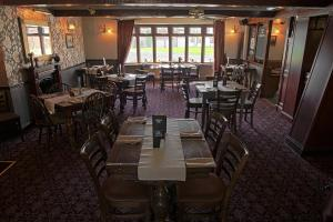 A restaurant or other place to eat at The Chequers Inn