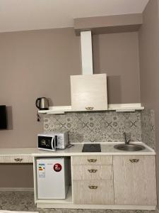 A kitchen or kitchenette at Heart Kiev Apart-Hotel