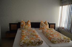 Ein Bett oder Betten in einem Zimmer der Unterkunft Bergpanorama Ruhla