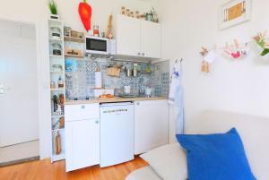 A kitchen or kitchenette at Beachfront Apartment Mala Tereza