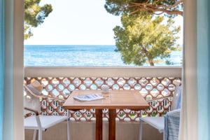 A balcony or terrace at La Pinède Plage