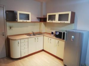 A kitchen or kitchenette at Hotel Central Razgrad