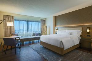 A bed or beds in a room at The Westin O'Hare