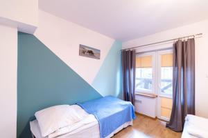 Łóżko lub łóżka w pokoju w obiekcie Apartamenty Vasco da Gama
