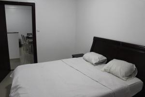 A bed or beds in a room at Residence Nadra