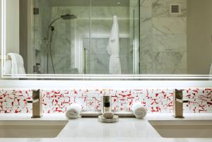 A bathroom at The Art Hotel Denver, Curio Collection by Hilton
