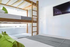A bunk bed or bunk beds in a room at Ayenda 1258 Boutique Laureles Home