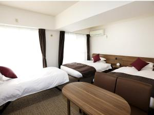 Tempat tidur dalam kamar di HOTEL MYSTAYS Ueno Iriyaguchi