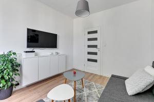 Telewizja i/lub zestaw kina domowego w obiekcie Apartament Nadmorski