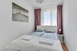 Łóżko lub łóżka w pokoju w obiekcie Apartament Nadmorski