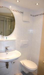 Ein Badezimmer in der Unterkunft Hotel Munding