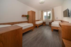 Postel nebo postele na pokoji v ubytování Hotel Panský dům