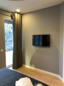 A television and/or entertainment center at Partner Guest House