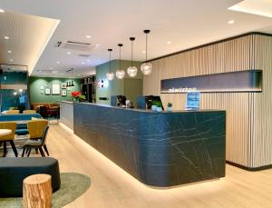 The lobby or reception area at zeitwohnhaus SUITE-HOTEL & SERVICED APARTMENTS