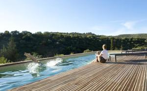 The swimming pool at or near Mansion with 3 bedrooms in Castelnou with wonderful mountain view shared pool furnished garden 25 km from the beach