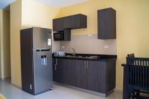 A cozinha ou cozinha compacta de Juanedu Suites