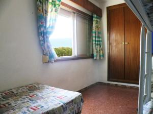 A bed or beds in a room at Apartment with 2 bedrooms in Isla Cristina with WiFi 300 m from the beach