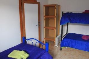 Una cama o camas cuchetas en una habitación  de Don Galle