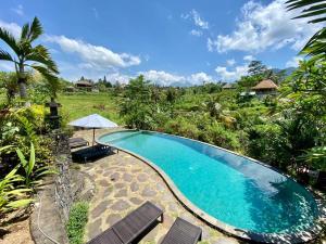 The swimming pool at or near Abian Ayu Villa