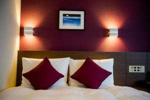 A bed or beds in a room at Best Western Plus Fukuoka Tenjin-minami