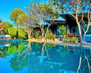 The swimming pool at or near Family House Zen Boutique Resort