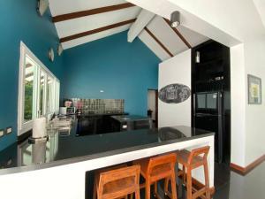 A kitchen or kitchenette at Krabi Beach House, SHA Certified