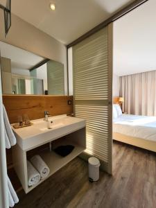 A bathroom at Hotel Brasserie JENNY - Spa & Fitness - near Basel