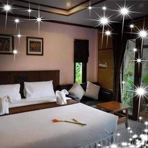 Ein Bett oder Betten in einem Zimmer der Unterkunft Seabreeze Hotel Kohchang