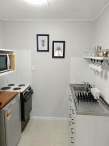 A kitchen or kitchenette at Linda's Place Private Apartment & Breakfast