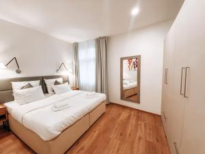 A bed or beds in a room at Residence Masna