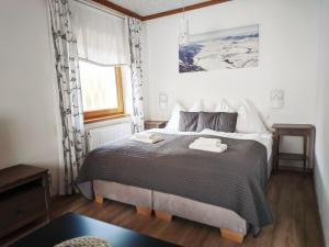 Posteľ alebo postele v izbe v ubytovaní Penzion Maria