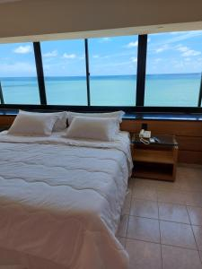 A bed or beds in a room at Euro Suite Recife Boa Viagem
