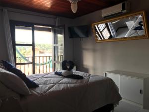 A bed or beds in a room at Pousada Azul dos Buzios