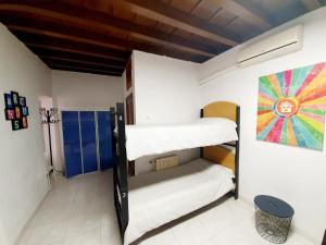 A bunk bed or bunk beds in a room at ARC House Cordoba