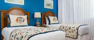 A bed or beds in a room at The Tuscany on Grace Bay