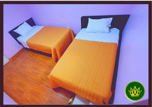 A bed or beds in a room at Hotel Rey de Oro