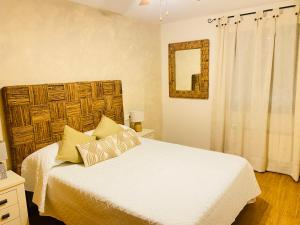 A bed or beds in a room at Chinchonspa