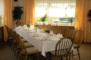 Ein Restaurant oder anderes Speiselokal in der Unterkunft Hotel Restaurant Windeck
