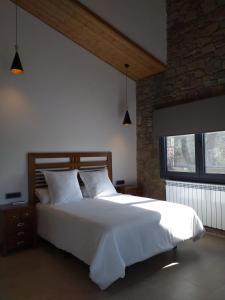 Cama o camas de una habitación en Casa rural Les Flors