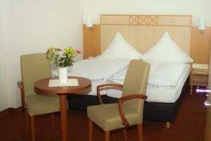 Ein Bett oder Betten in einem Zimmer der Unterkunft Hotel Restaurant Windeck