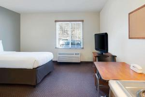 A television and/or entertainment center at WoodSpring Suites Baton Rouge East I-12