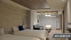 A bed or beds in a room at Sheng Shine Forest Resort