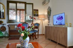 A television and/or entertainment center at Exlusive Pool Villa - Cascina Relais