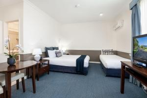 A bed or beds in a room at Hawkesbury Race Club Motel