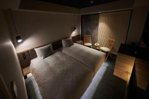 A bed or beds in a room at Hotel Resol Trinity Osaka