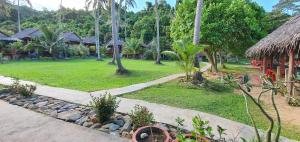 A garden outside Khim Vouch Iay Bungalow